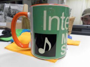 Tasse mit Werbedruck für Musikschule